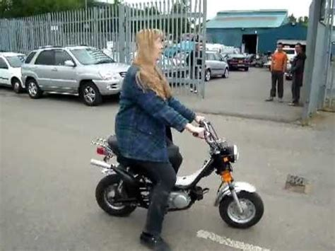 Ruthie riding our classic 1983 Yamaha Monkey bike for the